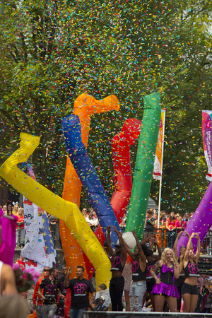 prinsengracht: Amsterdam, Netherlands - August 1, 2015: decorated boat at the annual event for the protection of human rights and civil equality - Gay Pride Parade on the Prinsengracht, Amsterdam Editorial