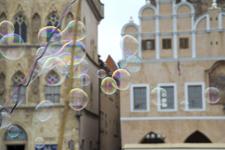 liquid reflect: Prague- July 23, 2014: Bubbles are blowing in the wind in Prague