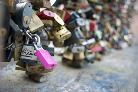 PRAGUE, CZECH REPUBLIC - july 22, 2015: Love locks in Prague. The locks are on a small pedestrian bridge in the Mala Strana district over a sidearm of the Vltava River. Stock Photo