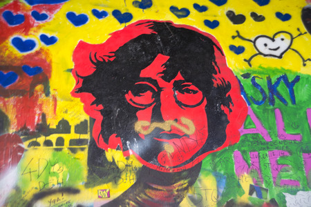 the beatles: PRAGUE, CZECH REPUBLIC - July 22: The Lennon Wall since the 1980s is filled with John Lennon-inspired graffiti and pieces of lyrics from Beatles songs on July 22, 2015 in Prague, Czech Republic Editorial