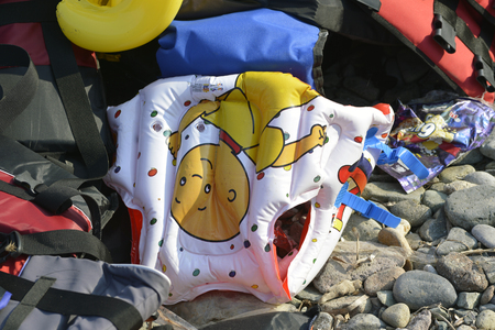 hot spot: LESVOS, GREECE OCTOBER 24, 2015: Lifejackets, rubber rings an pieces of the rubber dinghys discarded on a beach near Molyvos. Eftalou and Skala Sikaminia. Lesvos has been a hot spot for migrants and refugees arriving in inflatable boats from Turkey.