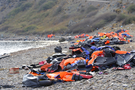 LESVOS, GREECE OCTOBER 24, 2015: Lifejackets, rubber rings an pieces of the rubber dinghys discarded on a beach near Molyvos. Eftalou and Skala Sikaminia. Lesvos has been a hot spot for migrants and refugees arriving in inflatable boats from Turkey.