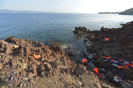 LESVOS, GREECE OCTOBER 12, 2015: Lifejackets, rubber rings an pieces of the rubber dinghys discarded on a beach near Molyvos. Eftalou and Skala Sikaminia. Lesvos has been a hot spot for migrants and refugees arriving in inflatable boats from Turkey.