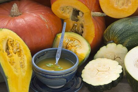 autmn: pumpkins and soup on gardentable in autmn