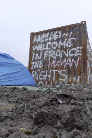 flee: Dunkerque, France-23 January 2016: Refugee camp Grande-Synthe in France is a muddy camp with a lot of dirty waste. People are cold and hungry.
