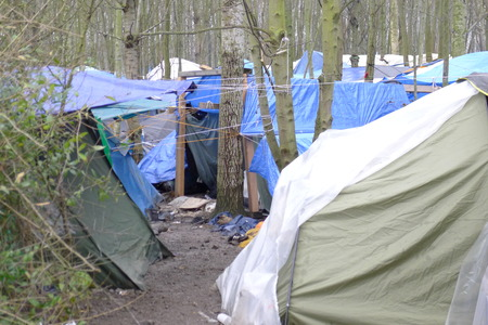 housing crisis: Dunkerque, France-23 January 2016: Refugee camp Grande-Synthe in France is a muddy camp with a lot of dirty waste. People are cold and hungry.