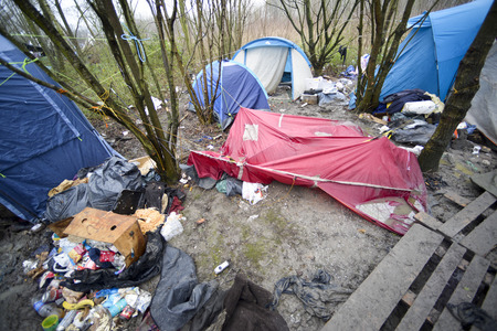 Dunkerque, France-24 January 2016: Refugee camp Grande-Synthe in France is a muddy camp with a lot of dirty waste. People are cold and hungry. Editorial