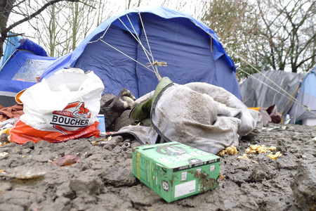 housing crisis: Dunkerque, France-24 January 2016: Refugee camp Grande-Synthe in France is a muddy camp with a lot of dirty waste. People are cold and hungry. Editorial