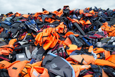 LESVOS, GREECE February 21, 2016: Lifejackets, rubber rings an pieces of the rubber dinghies left by refugees are making a mountain in Eftalou. Lesvos has been a hot spot for refugees.