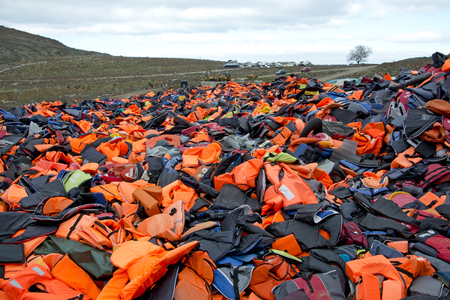 hot spot: LESVOS, GREECE February 21, 2016: Lifejackets, rubber rings an pieces of the rubber dinghies left by refugees are making a mountain in Eftalou. Lesvos has been a hot spot for refugees.