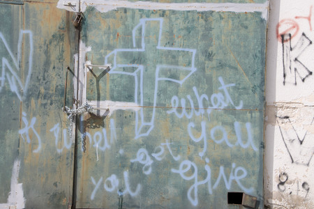 LESVOS, GREECE March 01, 2016: Words written by refugees and volunteers on walls at the Greek island Lesvos. Hotspot Moria, deportation center refugees. Editorial