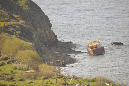 greece shoreline: Shipwreck at Lesvos Greece left after refugees crossing the Aegean sea from Turkey