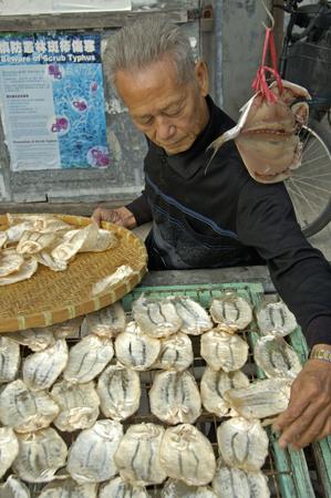 Hongkong, China, 04 December 2006: Food an fish market at beautiful traditional fischermans village Tai O, behind the big city Hongkong.
