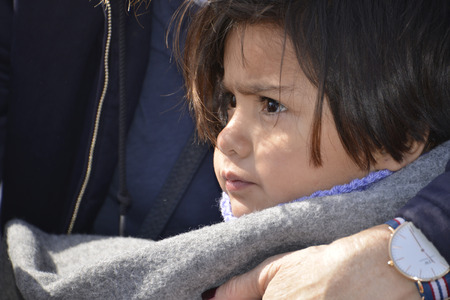Mytilini, Lesvos, Greece, 03-March-2016: Refugees child arriving at Lesvos. After they flee from their home country. They travel from Turkey to Greece to get to Europe. Editorial