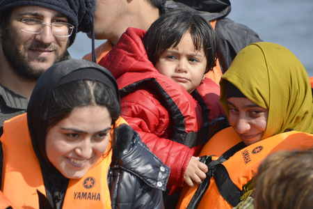 migrant: Mytilini, Lesvos, Greece, 03-March-2016: Refugees child arriving at Lesvos. After they flee from their home country. They travel from Turkey to Greece to get to Europe. Editorial