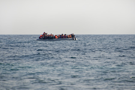 Mytilini, Lesvos, Greece, 25-February-2016: Refugees arriving at Lesvos in a rubber dinghy boat after they flee from their home country. They travel from Turkey to Greece to get to Europe.