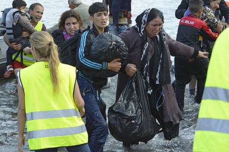 Lesvos, Greece- October 12, 2015, 2015. Refugee migrants, arrived on Lesvos in inflatable dinghy boats, they stay in refugee camps waiting for the ferry to mainland Greece continuing their journeys through Europe to seek asylum. Redactioneel