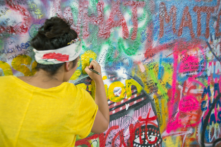 PRAGUE, CZECH REPUBLIC - July 22: The Lennon Wall since the 1980s is filled with John Lennon-inspired graffiti and pieces of lyrics from Beatles songs on July 22, 2015 in Prague, Czech Republic Editorial