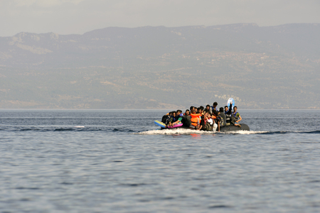 LESVOS, GREECE october 12, 2015: Refugees arriving in Greece in dingy boat from Turkey. These Syrian, Afghanistan and African refugees land their boat at the North coast of Lesvos near Molyvos, Eftalou and Skala Sikaminia Editorial
