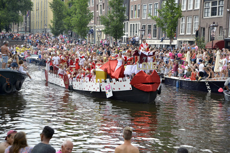 canal parade: Amsterdam, Netherlands - August 2, 2014: participants in the annual event for the protection of human rights and civil equality - Gay Pride Parade on the Prinsengracht, Amsterdam Editorial