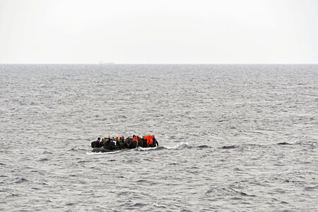 LESVOS, GREECE october 08, 2015: Refugees arriving in Greece in dingy boat from Turkey. These Syrian, Afghanistan and African refugees land their boat at the North coast of Lesvos near Molyvos, Eftalou and Skala Sikaminia
