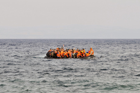 LESVOS, GREECE october 20, 2015: Refugees arriving in Greece in dingy boat from Turkey. These Syrian, Afghanistan and African refugees land their boat at the North coast of Lesvos near Molyvos, Eftalou and Skala Sikaminia