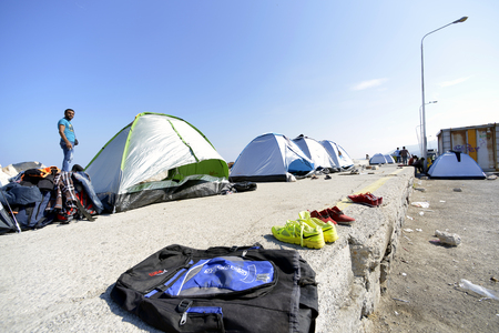 Lesvos, Greece- October 05, 2015. Refugee migrants, arrived on Lesvos in inflatable dinghy boats, they stay in refugee camps waiting for the ferry to mainland Greece continuing their journeys through Europe to seek asylum. Editorial