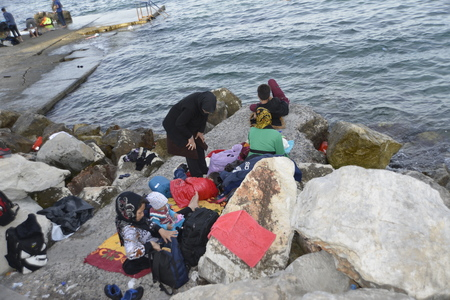 Lesvos, Greece- October 14, 2015, 2015. Refugee migrants, arrived on Lesvos in inflatable dinghy boats, they stay in refugee camps waiting for the ferry to mainland Greece continuing their journeys through Europe to seek asylum. Editorial