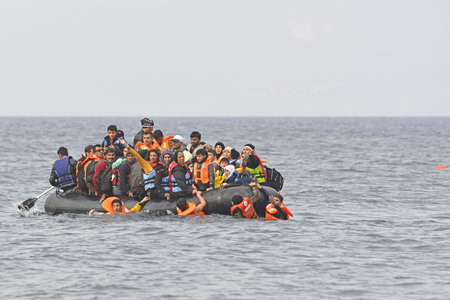 Lesvos, Greece- October 20, 2015. Refugee migrants, arrived on Lesvos in inflatable dinghy boats, they stay in refugee camps waiting for the ferry to mainland Greece continuing their journeys through Europe to seek asylum.