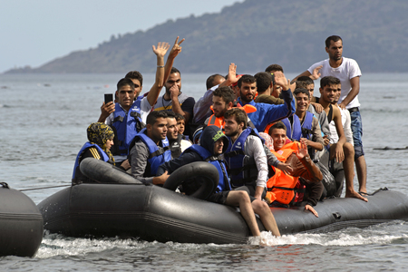LESVOS, GREECE october 12, 2015: Refugees arriving in Greece in dingy boat from Turkey. These Syrian, Afghanistan and African refugees land their boat at the North coast of Lesvos near Molyvos, Eftalou and Skala Sikaminia 報道画像