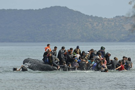 Lesvos, Greece- October 12, 2015, 2015. Refugee migrants, arrived on Lesvos in inflatable dinghy boats, they stay in refugee camps waiting for the ferry to mainland Greece continuing their journeys through Europe to seek asylum. 報道画像