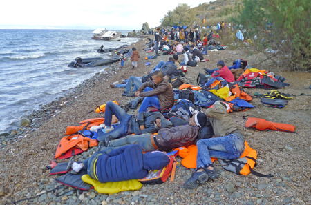 Lesvos, Greece-October 25, 2015: Refugee migrants, arrived on Lesvos in inflatable dinghy boats, they stay in refugee camps waiting for the ferry to mainland Greece continuing their journeys through Europe to seek asylum.