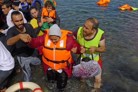 Lesvos, Greece- October 12, 2015, 2015. Refugee migrants, arrived on Lesvos in inflatable dinghy boats, they stay in refugee camps waiting for the ferry to mainland Greece continuing their journeys through Europe to seek asylum. Editorial
