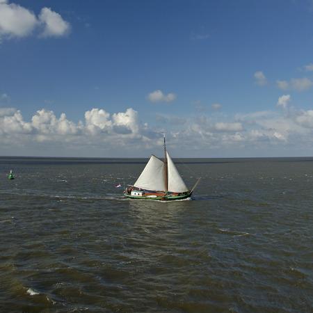 wadden: A sailboat on the Waddensea, Vlieland the Netherlands