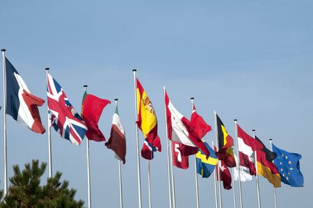 in unison: A row of flags from various European countries.