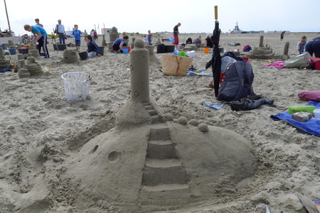 Making sandsculptures at the beach, the Netherlands