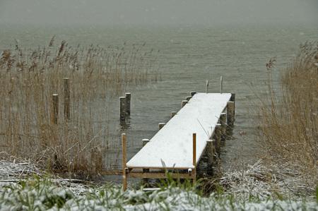 marken: A snowy dock in the traditional dutch village Marken, the Netherlands Stock Photo