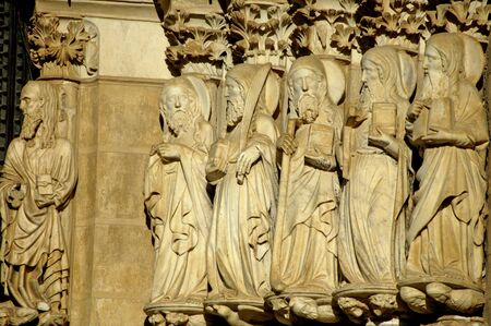 artisitc: A group of statues of saints in a church in Portugal.
