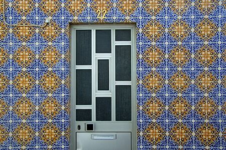 A geometrically pleasing door of a colourful house found in Atalaia.