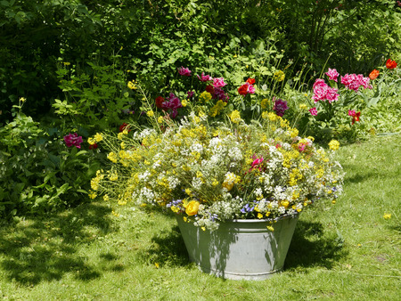 roadflower bouquets in a vintage tin bin in the garden
