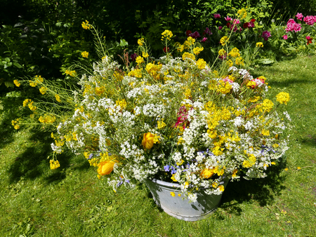 tin: roadflower bouquets in a vintage tin bin in the garden