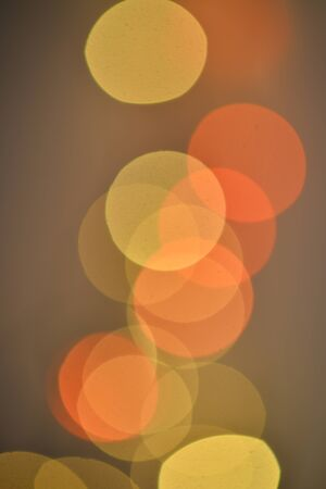 Red orange and yellow bokeh on a black background