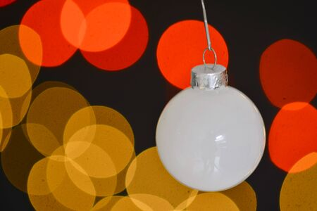A hanging christmas ball with bokeh background Stock Photo