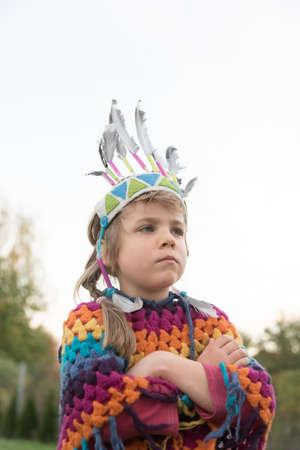 five years old: Five years old girl as Amercian Indian with contemplative look