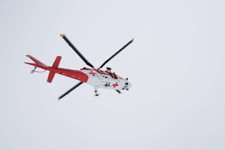 rescue helicopter: Rescue helicopter in action in high mountains