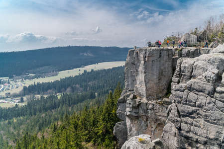 gory: People enjoying the view from a vantage point located on a huge rock hill in Gory Stolowe, Poland