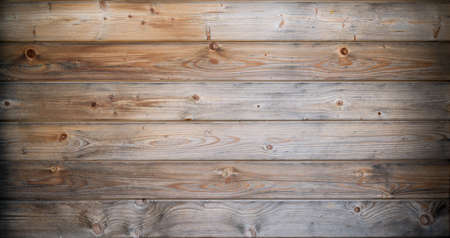 A texture of an old sun bleached wood, with vignette effect