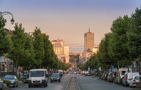 baudouin: Warm light of setting sun reflecting beautifully in distant office buildings. Boulevard Baudouin, Brussels.