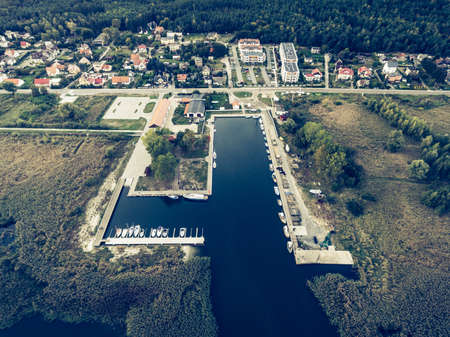 population growth: Aerial view on a harbor in Katy Rybackie, Poland. Retro style.