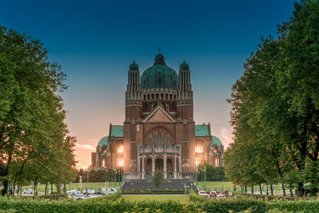National Basilica of the Sacred Heart in Brussels lit from its back by the light of setting sun Lizenzfreie Bilder